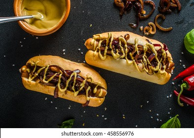 All beef hotdogs, delicious full of meat with caramelized red onion, french mustard and chilli dogs