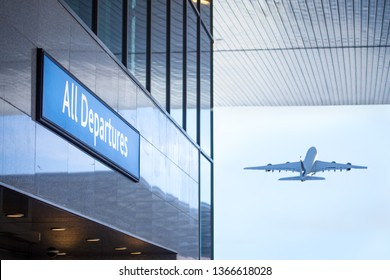 all Departure sign at Airport Building with Aircraft taking off in background