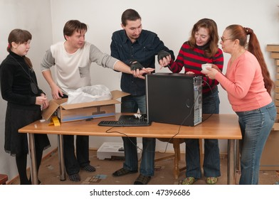 All family was gathered to look at the new computer.