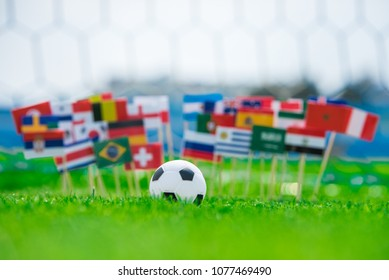 All Flags of Football world cup in Russia 2018. Footbal net in background. Flags on football pitch, tournament photo. Fans, support concept photo