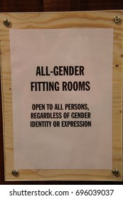 all gender fitting rooms sign