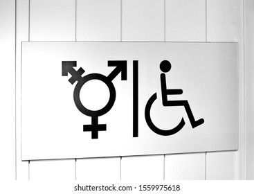 All gender toilet sign on the door. Anyone can use, regardless of gender identity or expression. Black and white photo