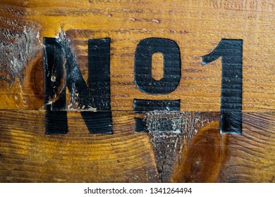 All the glamour is gone: Number one painted on old wood box