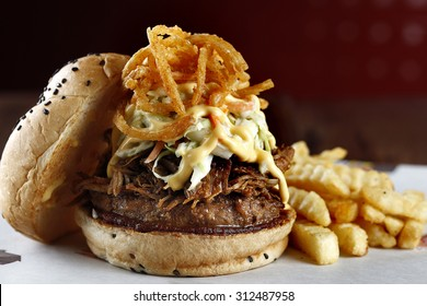All Japanese beef burger with onions, pulled pork, coleslaw and fries.