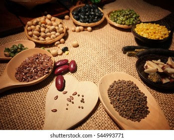 All kind of high protein mixed beans contained in beautiful wooden spoon on sack pattern