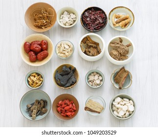 All kinds of Chinese herbal medicine in the porcelain cup
