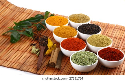 All kinds of dry spicy powders on mat background