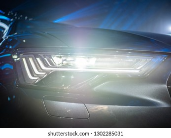 All LED adaptive headlight of a modern car. Headlight consists of individual matrix LED units that can be switched on, off or dimmed, depending on driving conditions.