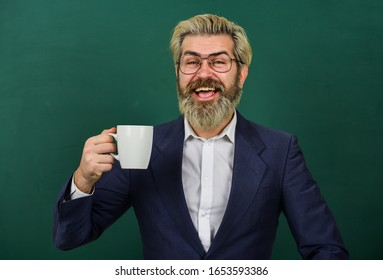 All I need is caffeine. Happy teacher hold coffee cup green chalkboard. Enjoying hot caffeine drink. Coffee break. Using caffeine stimulant. Caffeine addiction.