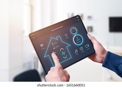 All in one smart home control system app concept on Tablet display in man hand