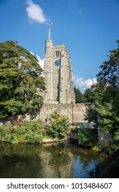 All Saint's church tower and the river Medway at Maidstone, Kent UK