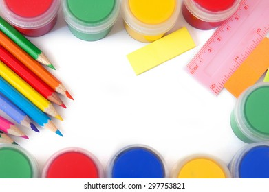 All for school. Colorful pencil and paints isolated on white background