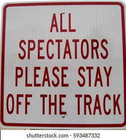 All Spectators Please Stay off Track Sign