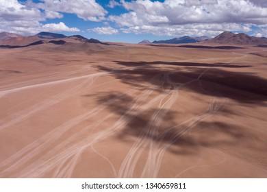 All Terrain Vehicle Tracks in Altiplano Desert near Uyuni, Bolivia. Aerial Drone Scene
