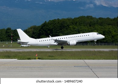 All white regional jet running for take off