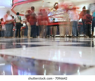 an all you can eat pizza/cafeteria joint - the shot is from the checkered floor looking across at the food line and with a time exposure, some of the customer movement is blurred