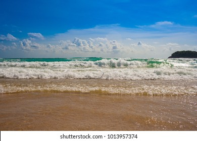 All you need is a great blue sky, white clouds, turquoise water, rhythmic waves and fine sand to have a great vacation at Kata Beach, Phuket, Thailand.