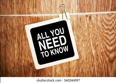 All You Need To Know Motivation quote written on a chalkboard