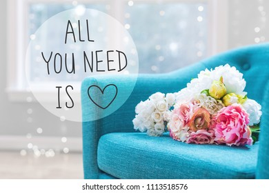 All You Need Is Love message with flower bouquets with turquoise chair