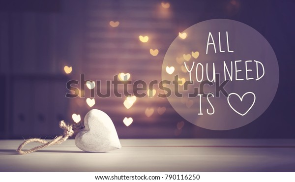 All You Need Is Love message with a white heart with heart shaped lights