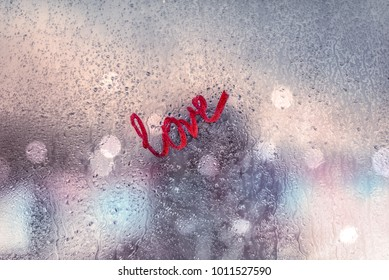 All you need is love, strong message of love, urban window covered with raindrops, romantic relations after a first date, love and passion concept