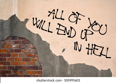 All Of You Will End Up In Hell - handwritten graffiti sprayed on the wall - damnation and religious punishment of sinful sinners because of sins and immorality
