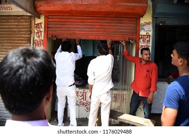 Allahabad: Congress workers  close shops during Bharat Band protest against Prime minster Narendra Modi over hike price of petrolium, in Allahabad on 10-09-2018.