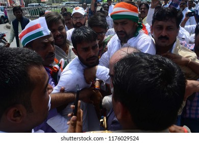 Allahabad: Congress workers stop as a NSUI worker tried to Self-destruction during Bharat Band protest against Prime minster Narendra Modi over hike price of petrolium, in Allahabad on 10-09-2018.