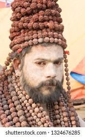 Allahabad / India 18 January 2019 Portrait of Naga sadhu with Rudraksha garland at the Kumbh Mela in Allahabad Uttar Pradesh India