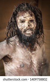 Allahabad, India- February 01 2019: Portrait of a sadhu  covered in ash at the khumb mela festival, Allahabad, India.