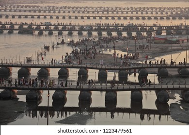 ALLAHABAD, INDIA - FEBRUARY 06, 2013: Thousands of Hindu devotees crossing the pontoon bridges over the Ganges River at Maha Kumbh Mela festival in Allahabad, Indi