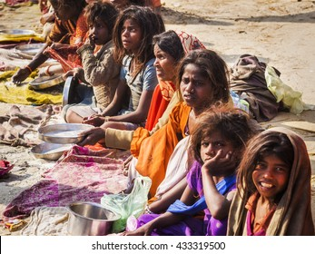 Allahabad, India - February 10: Poor Indian woman and children begging for food on the streets in Allahabad, Uttar Pradesh, India.