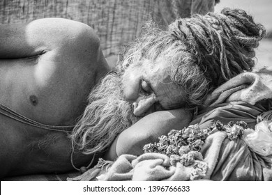 Allahabad, India- January 31 2019: Portrait of a sadhu sleeping at the city of Allahabad, India. Sadhu is a holy man, who have chosen to live an ascetic life.