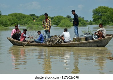 Allahabad: People shift to a safer place after their houses submerged with water of flooded River Ganga at Jhunsi area in Allahabad on 10-09-2018.