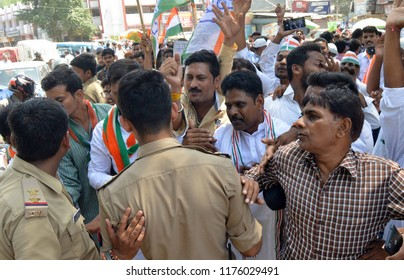Allahabad: Police stop Congress workers hold Chakka jaam protest during Bharat Band protest against Prime minster Narendra Modi over hike price of petrolium, in Allahabad on 10-09-2018.
