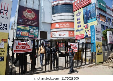 Allahabad: Security guards close a malls gate during Bharat Band protest against Prime minster Narendra Modi called by Congress over hike price of petrolium, in Allahabad on 10-09-2018.