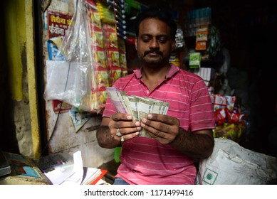 Allahabad: A shopkeeper count Indian currency as Indian Rupee arrive 70.98 in behalf of US doller, in Allahabad on 31-08-2018.