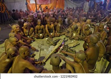ALLAHABAD, UTTAR PRADESH, INDIA - FEBRUARY 06, 2013: Hindu Sannyasis (monks) and pilgrims at Maha Kumbh Mela festival gathered for joint praying. The world's largest religious gathering