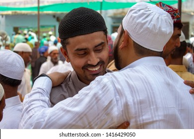 Allahabad, Uttarpradesh / India - June 5, 2019: Two muslim friends hugging and wishing eachother a Happy Eid inside a Mosque compound.