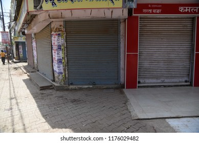 Allahabad: A view of close shops during Bharat Band protest against Prime minster Narendra Modi over hike price of petrolium, in Allahabad on 10-09-2018.