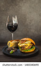 All-American burger.  A double wagyu fat and chuck blend patty and bacon ketchup in a brioche bun.  Served with Mexican corn and sauteed thyme mushrooms.