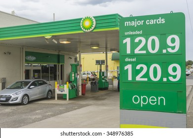 Allansford, Australia - November 25, 2015: Close-up of petrol price sign with car leaving the BP service station in Allansford, Victoria. There are around 1400 BP service stations in Australia.