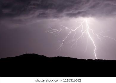 Allariz, Galicia / Spain - Jun 21 2018: lightning strike during a thunderstorm.