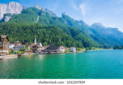 Alleghe is a charming mountain village located in a unique natural setting overlooking its fascinating lake , in the geographic heart of the Dolomites UNESCO World Natural Heritage, Belluno, Italy