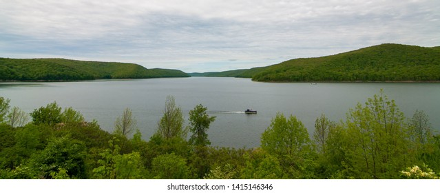 The Allegheny Reservoir in Warren County, Pennsylvania, USA behind Kinzua Dam on a spring day with a houseboat on the water