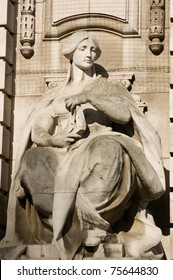 Allegorical figure representing navigation.  Ouside of Admiralty Arch between The Mall and Trafalgar Square in Westminster, London.
