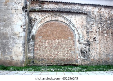 allegory of the boarded door, without help, without exit,Half-point arch covered with bricks in church of Soria, Spain,visual allegories, visual metaphors, photographic allegories,