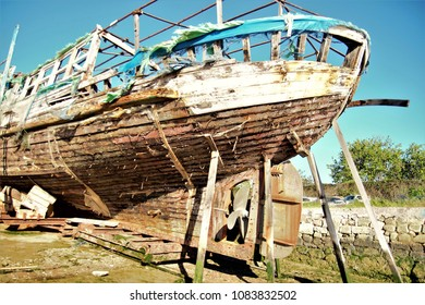 allegory of death, visual allegories, visual metaphors, photographic allegories, photographic metaphors, the boat called vaporcito,old tourists boat rotting in the sun in Puerto de Santa Maria, Spain,
