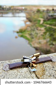 allegory of eternal love, Photograph of love padlocks in the foreground with the river Tagus blurred background in Toledo,Spain, visual allegories, visual metaphors, photographic allegories,