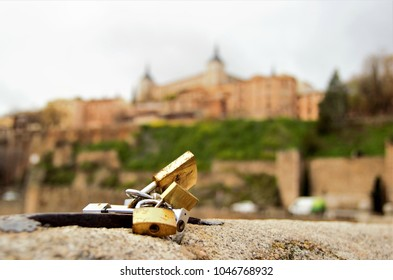 allegory of eternal love, Photograph of love padlocks in the foreground with El Alcazar blurred background in Toledo, Spain,visual allegories, visual metaphors, photographic allegories,
